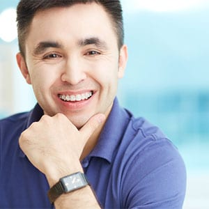 adult man in braces smiling
